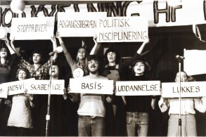 """Political theater in response to the attempts to dismantle the university. On the top it says: """"Preselection tests"""", """"Restrictions on access"""", """"Political disciplination"""". On the bottom it says: """"Social science basic-education closes"""". Social Sciences education was closed by the parlament for differing too much from the political line of society, only to be reopened again after much protesting."""