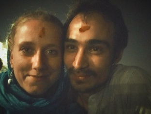 blessed lovers at evening boat ride in Varanasi