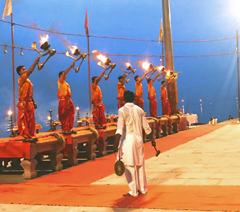 priests in Varanasi, morning ceremony by the Ganga